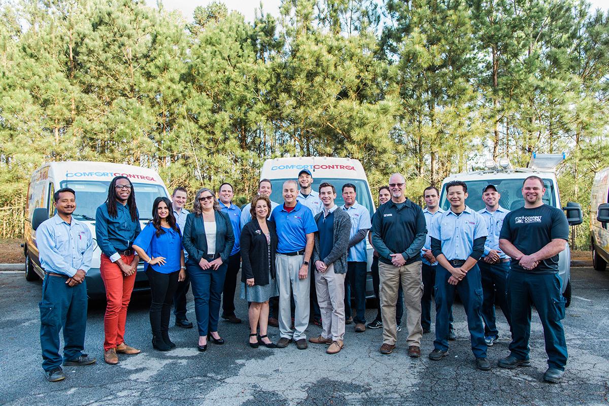 comfort control team in front of vans